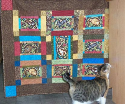 Ellie Marie Inspecting Her Quilt